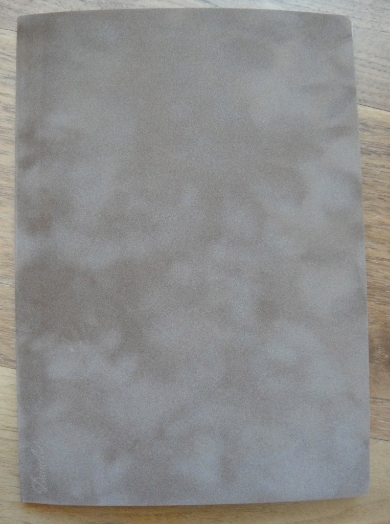 The color of the cover is a bit more brown and less grey than the picture shows.