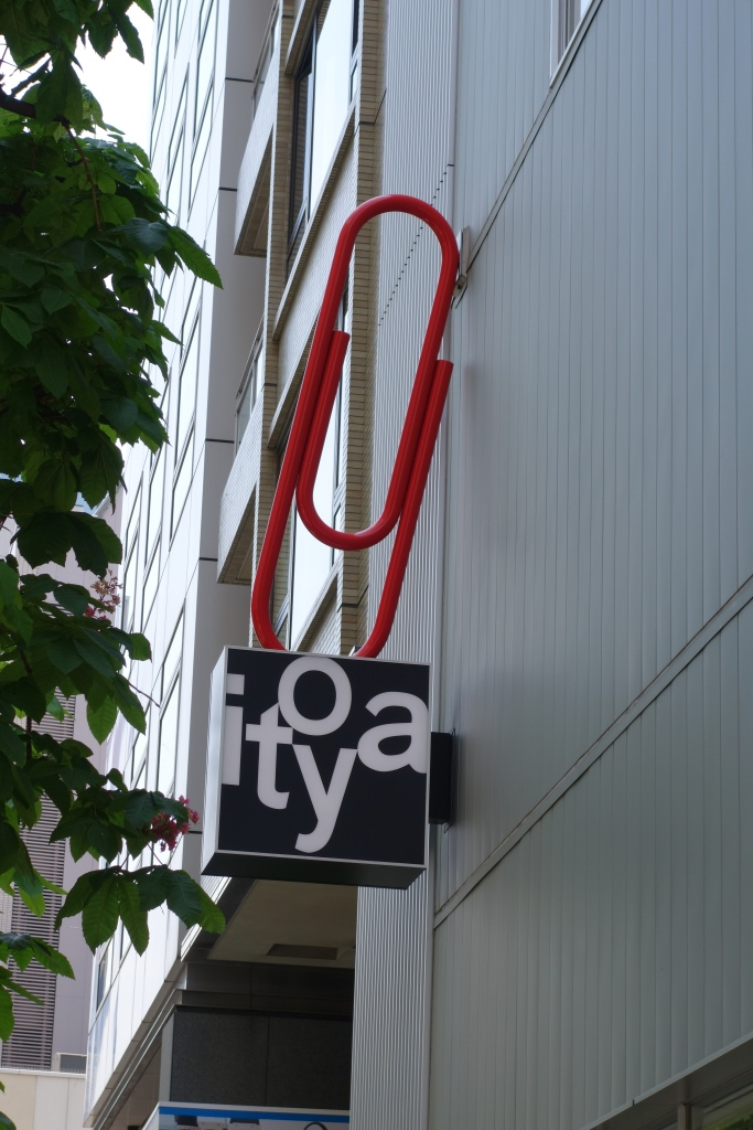 Itoyas famous red paper clip sign out their temporary store location.