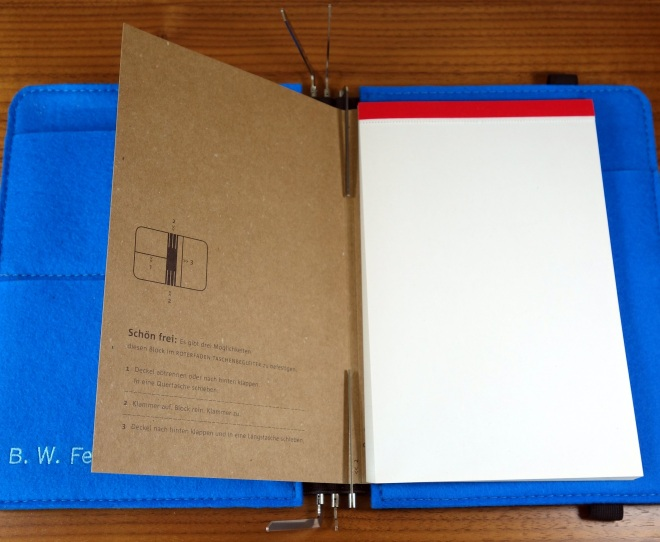 I always fill from the back forward.  This is the notepad.  It comes with a cardboard cover and the pages are blank on one side and graph on the other.
